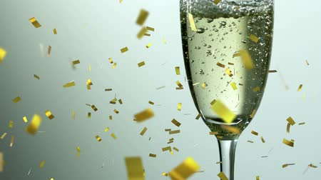 flet : Animation of a full champagne glass with golden confetti falling during New Year Eve celebrations on white background