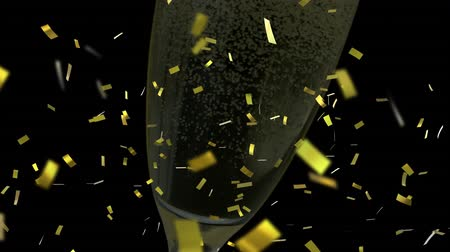 champagne flute : Animation of a full champagne glass with golden confetti falling during New Year Eve celebrations on black background