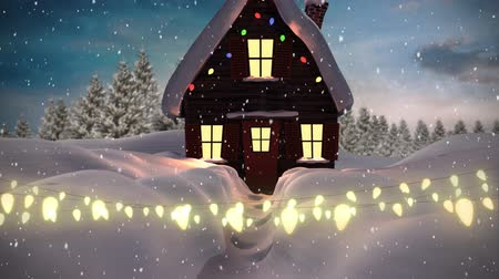 changing lights : Animation of winter scenery with glowing string of Christmas fairy lights with house, fir trees and snow falling in the background