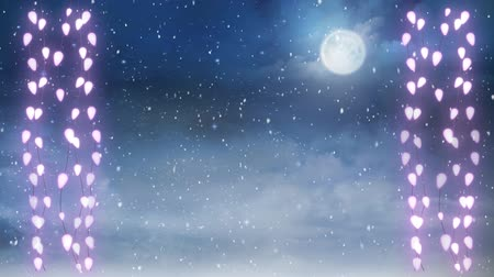 changing lights : Animation of winter scenery with two glowing strings of Christmas fairy lights, full moon and snow falling in the background Stock Footage