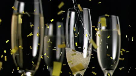 flet : Animation of champagne being poured into a glass with three more glasses and golden confetti falling during New Year Eve celebrations on black background