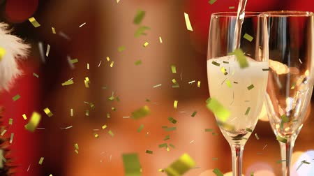 flet : Animation of champagne being poured into glasses with golden confetti falling during New Year Eve celebrations with Santa hat in the background