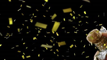 цифровой сформированный образ : Animation of hand of person opening bottle of champagne and cork shooting out with golden confetti falling during New Year Eve celebrations on black background