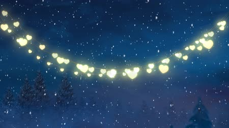 changing lights : Animation of winter scenery with glowing string of Christmas fairy lights, fir trees and snow falling in the background