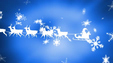 sob : Animation of a white silhouette of Santa Claus in sleigh being pulled by reindeers from right to left at Christmas time with snow falling and defocussed glowing light on blue background Dostupné videozáznamy