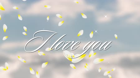 i love you : Animation of the words I Love You written in white with floating white and yellow petals with clouds on blue sky in the background Stock Footage