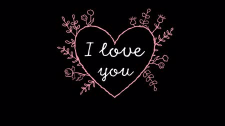 espaço de texto : Animation of the words I Love You written in white with pink decoration in heart shaped frame with floral decoration on black background