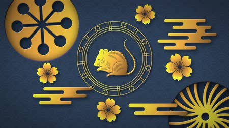 lunar : Animation of a golden rat in a spinning wheel with turning gold circular patterns and flowers on a blue background 4k Stock Footage