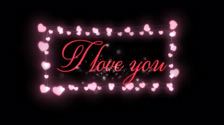 i love you : Animation of the words I Love You written in pink with glowing fairy lights frame on black background