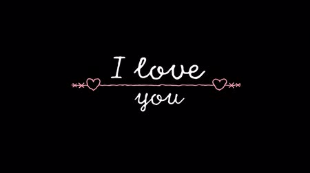i love you : Animation of the words I Love You written in white with pink decoration with hearts on black background Stock Footage