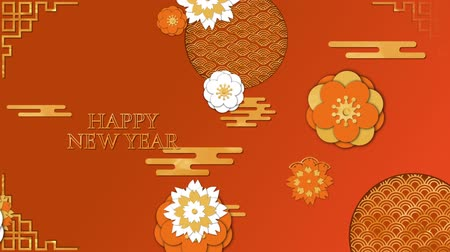 cny : Animation of the words Happy New Year, written in yellow letters with moving yellow, orange and white flowers and patterns on an orange background Stock Footage