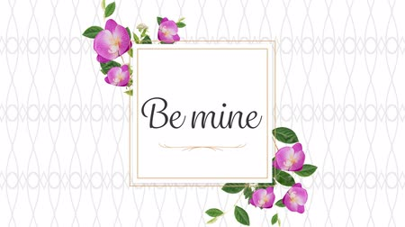 desenli : Animation of the words Be Mine written in black in pink frame with flowers on white patterned background Stok Video