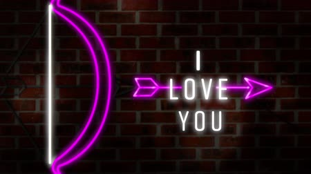 i love you : Animation of the words I Love You in white neon font with bow and arrow on red brick wall Stock Footage