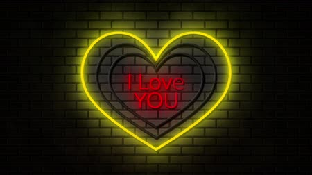 я тебя люблю : Animation of the words I Love You in red neon font with flickering white and yellow hearts on brick wall