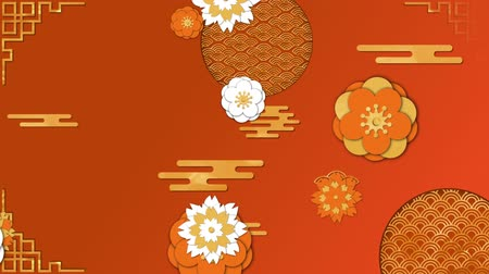 cny : Animation of moving yellow, orange and white flowers and patterns on an orange background Stock Footage