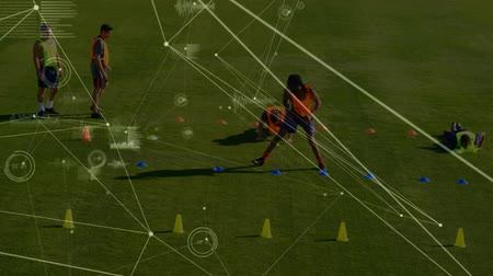 escopo : Animation of a network of connections, analytics and data processing, with a male sports team training on a playing field in the background