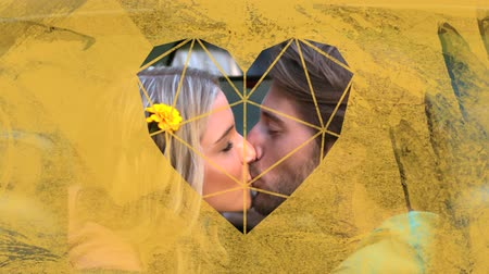 visto : Animation of the side view close up of a happy Caucasian couple sitting in a car kissing seen through a yellow heart shaped window in the foreground Stock Footage