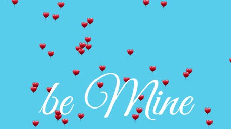 febrero : Animation of the words Be Mine written in white text, with red heart shaped balloons floating up on a blue background