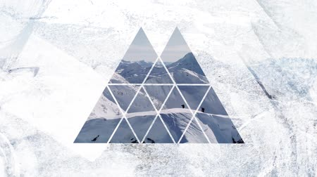 visto : Animation of two distant figures walking on a snow covered mountain range seen through a white double peaked triangular shaped window in the foreground