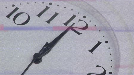minutos : Animation of a screen with bands of interference and a close up of part of a white analogue clock face with black hands and numbers moving in fast motion in the background