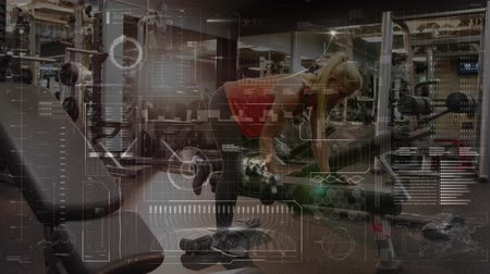 escopo : Animation of data processing, scope scanning and analytics with a blonde Caucasian woman lifting dumbbells at a gym in the background Vídeos