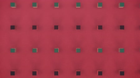 fixní : Animation of 3d black and green cubes in formation on a red background