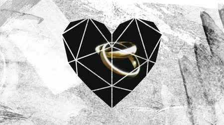 ingressou : Animation of two linked rings on a black background seen through a white heart shaped window in the foreground Stock Footage