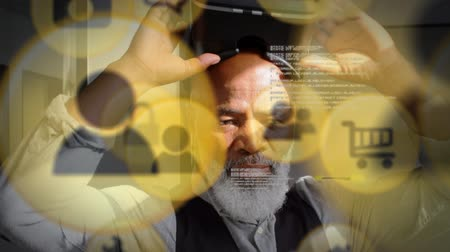 social change : Animation of yellow network connection and data sharing icons with a senior African American man putting on a VR headset in the background Stock Footage