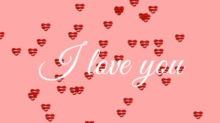 hayranlık : Animation of the words I Love You written in white text, with striped red heart shaped balloons floating up on a pale pink background Stok Video