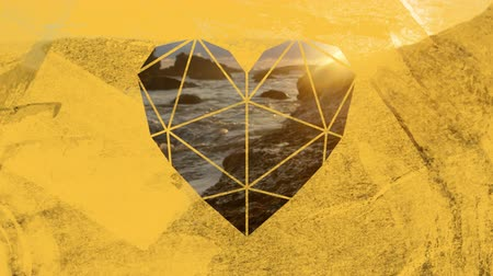 visto : Animation of a coastline and rocks in sea at sunset seen through a yellow heart shaped window in the foreground Stock Footage