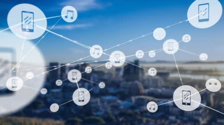 databáze : Animation of network of connections and icons moving over out of focus cityscape with modern office buildings in the background. Digital network of global connections networking business concept.