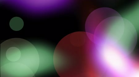боке : Animation of out of focus multi coloured bokeh spotlights moving around in hypnotic motion bokeh on dark glowing background. Seamless loop of digital motion.