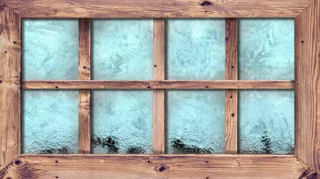 pane : Animation of frost setting on glass from top to bottom, transitioning and disappearing in cold winter on black background. Cold weather climate change domestic heating concept.