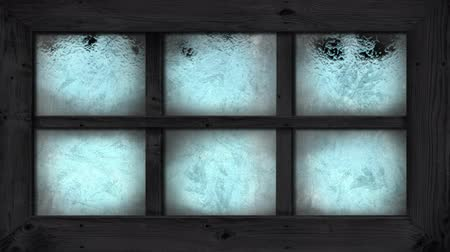 janeiro : Animation of frost setting on glass from bottom, transitioning and disappearing in cold winter on black background. Cold weather climate change domestic heating concept.