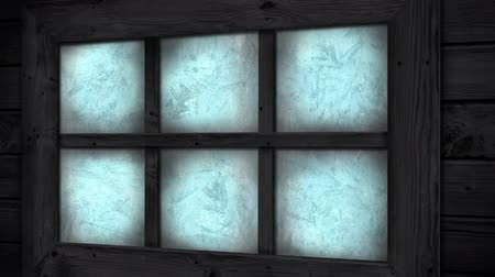 pane : Animation of frost setting on glass from left to right, transitioning and disappearing in cold winter on black background. Cold weather climate change domestic heating concept.