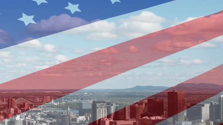 čtvrtý : Animation of waving American flag in front of a modern cityscape on a sunny day with clouds on blue sky in the background. Patriotism and modern city image combination concept. Dostupné videozáznamy