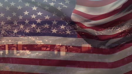 kombináció : Animation of waving American flag in front of a modern cityscape on a sunny day with clouds on blue sky in the background. Patriotism and modern city image combination concept. Stock mozgókép