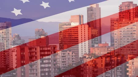 čtvrtý : Animation of waving American flag in front of a modern cityscape on a sunny day with mountains and blue sky in the background. Patriotism and modern city image combination concept. Dostupné videozáznamy