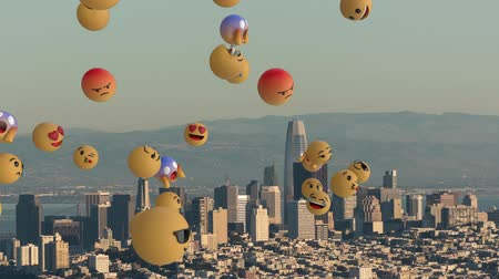 lol : Animation of a group of multiple emoji icons flying from left to right over cityscape with clouds on blue sky in the background. Global social networking concept digital composite.