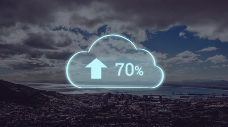 procent : Animation of blue cloud with percent increasing from zero to one hundred over cityscape with clouds on blue sky in the background. Global networking cloud computing in modern world concept combination image.