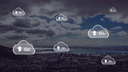 割合 : Animation of white clouds with percent increasing from zero to one hundred over cityscape with clouds on blue sky in the background. Global networking cloud computing in modern world concept combinati