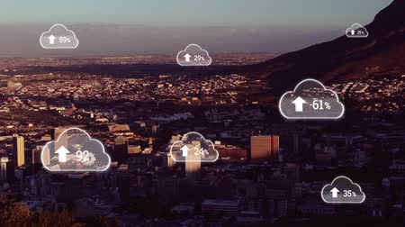 digitálisan generált : Animation of white clouds with percent increasing from zero to one hundred over cityscape with clouds on blue sky in the background. Global networking cloud computing in modern world concept combination image. Stock mozgókép
