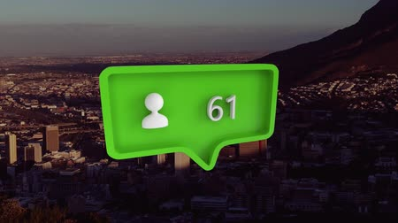 組み合わせ : Animation of green speech bubble with person icon filling up with percent increasing from zero to one hundred over cityscape with clouds on blue sky in the background. Global networking business trave