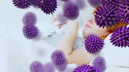 koróna : Animation of purple macro corona virus spreading and floating with a sick Caucasian woman lying in bed, coughing and sneezing using tissues in the background. Global health warning scare spreading infections concept digital composite.
