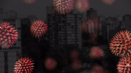 microbio : Animation of red macro corona virus spreading and floating with cityscape in the background. Global health warning scare spreading infections concept digital composite.