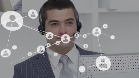 yardım hattı : Animation of network of connections with people icons with a Caucasian businessman wearing phone headset in a busy office in the background. Global networking and connections concept digital composite.