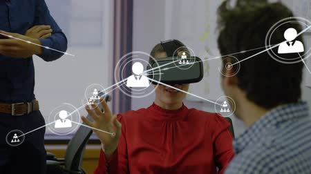 social change : Animation of network of connections with people icons with Caucasian woman wearing a Virtual Reality headset in the background. Global networking virtual reality and connections concept digital composite. Stock Footage