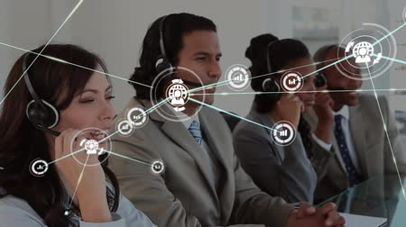 телефон доверия : Animation of network of connections with globe and statistics icons with a group of office workers wearing phone headsets in a busy office in the background. Global networking and connections concept digital composite. Стоковые видеозаписи
