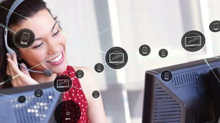 yardım hattı : Animation of network of connections with smartphone and computer icons with a Caucasian businesswoman wearing phone headset in a busy office in the background. Global networking and connections concept digital composite.