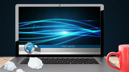 núpcias : Animation of the news screen with the words Fake News written in blue on blue and white banner, with glowing blue flowing lines of information displayed on laptop computer screen on blue background. Global technology media and information network concept  Stock Footage